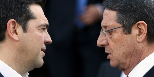 Cypriot President Nicos Anastasiades (R) and Greek Prime Minister Alexis Tsipras talk outside the Presidential Palace in Nicosia, Cyprus January 28, 2016. Greece, Israel and Cyprus will explore the possibility of building a natural gas pipeline to Europe, tapping huge gas reserves discovered in the eastern Mediterranean in recent years, leaders of the three countries said on Thursday. REUTERS/Yiannis Kourtoglou