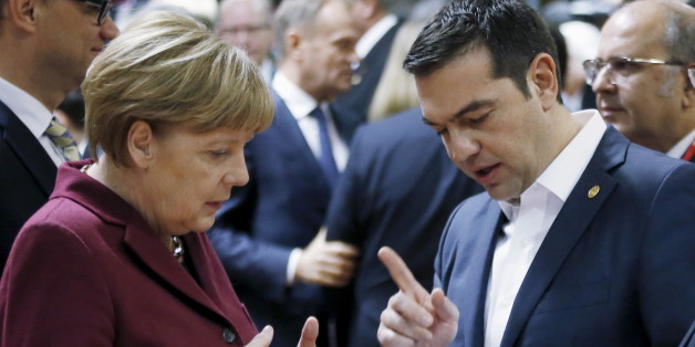 Germany's Chancellor Angela Merkel listens to Greece's Prime Minister Alexis Tsipras (R) during a European Union leaders summit in Brussels, Belgium, October 15, 2015.   REUTERS/Francois Lenoir