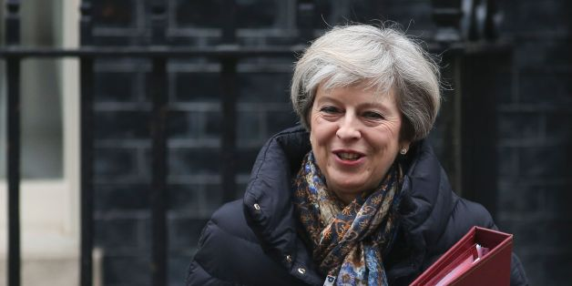 Britain's Prime Minister Theresa May leaves 10 Downing Street in central London on January 25, 2017 to attend the weekly Prime Minister's Questions in the House of Commons.