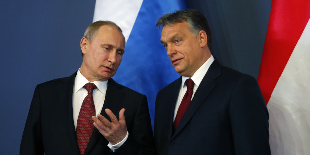 Russian President Vladimir Putin and Hungarian Prime Minister Viktor Orban (R) arrive for a joint news conference in Budapest February 17, 2015. Putin will discuss Russian gas supplies to Hungary when he visits Budapest on Tuesday, an adviser to the Russian president said on Monday. REUTERS/Laszlo Balogh (HUNGARY  - Tags: POLITICS)