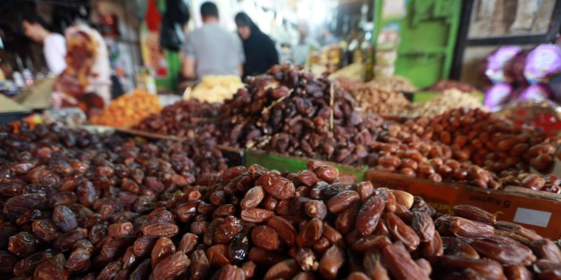 Dates, which are eaten to break a fast, are seen on sale at a market in Gaza City on the eve of the start of the holy Muslim fasting month of Ramadan, on July 9, 2013. During Ramadan, one of the five main religious obligations under Islam,  Muslims are required to abstain from food and from drinking liquids, smoking and having sex from dawn until dusk. AFP PHOTO/MOHAMMED ABED        (Photo credit should read MOHAMMED ABED/AFP/Getty Images)