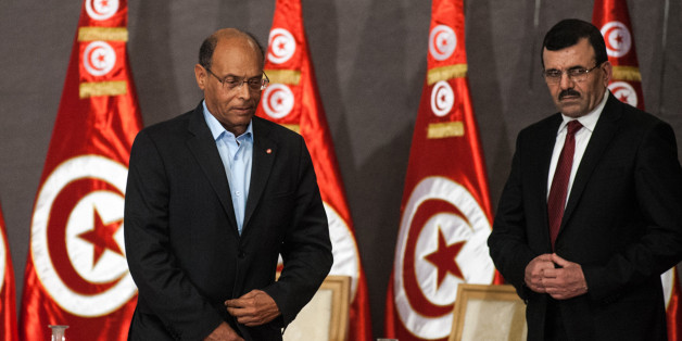 TUNIS, TUNISIA - OCTOBER 5: Tunisian President Moncef Marzouki (C), Tunisian Prime Minister Ali Laarayedh (R) and Tunisian Constituent Assembly President Mustapha Ben Jaafar (L) attend a meeting as part of the dialogue between Tunisia's ruling Islamists and the opposition at the Palais des Congres on October 5, 2013 in Tunis,Tunisia. (Photo by Amine Landoulsi/Anadolu Agency/Getty Images)