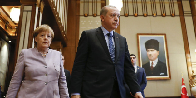 Refile with corrected typo - Turkish President Recep Tayyip Erdogan and German Chancellor Angela Merkel walk past a picture of Turkish Republic state founder Kemal Ataturk before their bilateral meeting at the presidential palace during the first visit since July's failed coup in Ankara, Turkey, February 2, 2017.      REUTERS/Umit Bektas      TPX IMAGES OF THE DAY