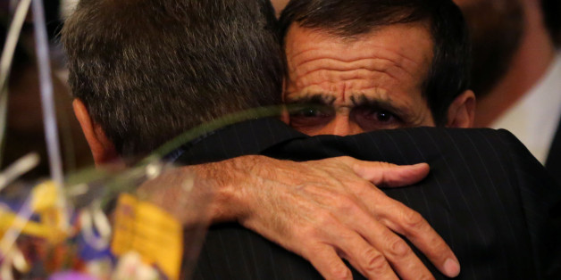 Iranian Ali Vayeghan hugs his brother Hossein as he arrives at Los Angeles International airport after after a federal judge ordered the visa-holder's safe return to Los Angeles, California, U.S., February 2, 2017.   REUTERS/Mike Blake