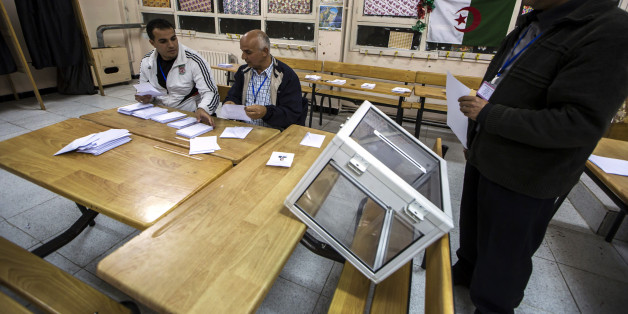 Election workers count ballots at the end of voting for presidential election at a polling station in Algiers April 17, 2014. Algerians voted on Thursday in an election President Abdelaziz Bouteflika is expected to win after 15 years in power, despite speaking only rarely in public since suffering a stroke in 2013.     REUTERS/Zohra Bensemra (ALGERIA - Tags: POLITICS ELECTIONS)