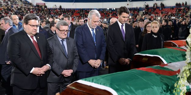 Canadian Prime Minister Justin Trudeau (right to left) Quebec Premier Philippe Couillard, Quebec City Mayor Regis Labeaume and Montreal Mayor Denis Coderre pay their respects by the caskets of the six victims of the Quebec City mosque shooting at the Maurice Richard Arena in Montreal,on February 2, 2017.Canadian Prime Minister Justin Trudeau on Thursday attended the funeral of two Algerians and a Tunisian man killed with three others in a mosque shooting, as he seeks to pull together a nation sh