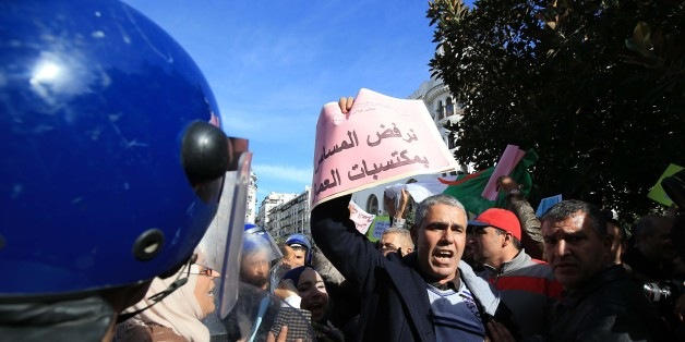 An Algerian trade unionist shouts slogans as they gather outside the People's National Assembly bulding in the capital Algiers on November 27, 2016, to portest the pension reform that is set to be debated by deputies.  (Photo by Billal Bensalem/NurPhoto via Getty Images)