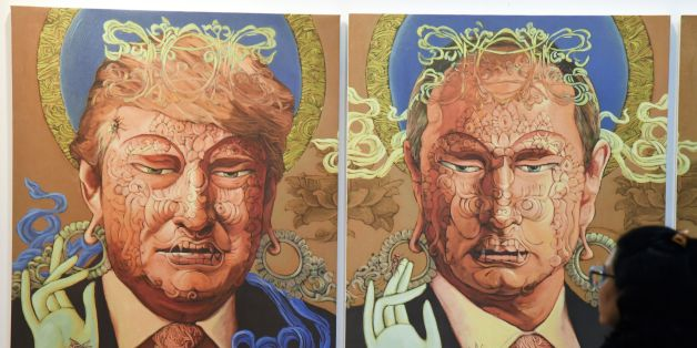 A visitor looks at a painting representing US President Donald Trump (L) and Russian President Vladimir Putin made by Nepalese artist Sunil Sidgel at the India Art Fair in New Delhi on January 2, 2017. / AFP / Dominique FAGET / RESTRICTED TO EDITORIAL USE - MANDATORY MENTION OF THE ARTIST UPON PUBLICATION - TO ILLUSTRATE THE EVENT AS SPECIFIED IN THE CAPTION        (Photo credit should read DOMINIQUE FAGET/AFP/Getty Images)
