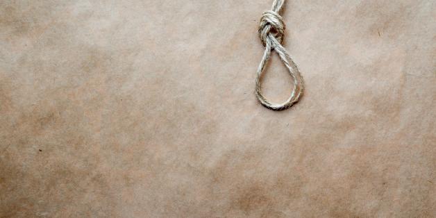 concept hangman's knot on kraft paper backgroun close up