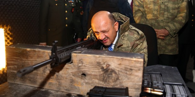 KIRIKKALE, TURKEY - JANUARY 11: Turkish National Defense Minister Fikri Isik (C) performs a test-fire with MPT-76 National Infantry Rifle during the delivery ceremony in Kirikkale, Turkey on January 11, 2017. (Photo by Evrim Aydin/Anadolu Agency/Getty Images)