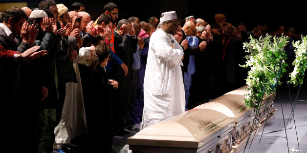 People pray during a funeral ceremony for three of the victims of the deadly shooting of the Quebec Islamic Cultural Centre at the Congress Center in Quebec City, February 3, 2017. REUTERS/Mathieu Belanger