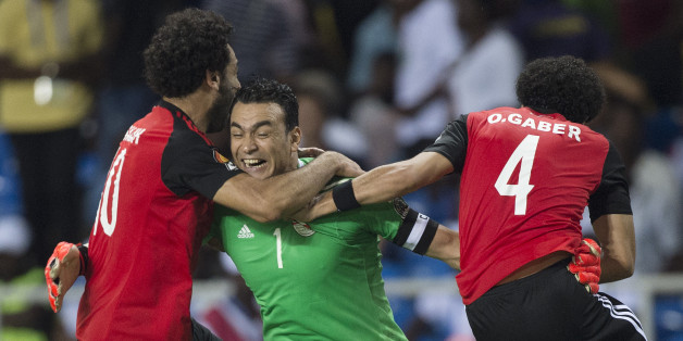 LIBREVILLE, GABON - FEBRUARY 01: Goalkeeper ESSAM KAMAL TAWFIK ELHADARY of Egypt celebrates winning the match with MOHAMED SALAH and OMAR MAHMOUD SAYED GABER during the semi-final match between Burkina Faso and Egypt at Stade de L'Amitie on February 01, 2017 in Libreville, Gabon. (Photo by Visionhaus/Corbis via Getty Images)