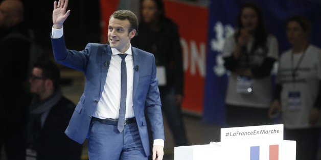 Emmanuel Macron, head of the political movement En Marche !, or Onwards !, and candidate for the 2017 presidential election, arrives on stage during a campaign rally in Lyon, France, February 4, 2017. REUTERS/Robert Pratta