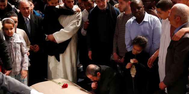 People mourn during a funeral ceremony for three of the victims of the deadly shooting of the Quebec Islamic Cultural Centre at the Congress Center in Quebec City, February 3, 2017. REUTERS/Mathieu Belanger