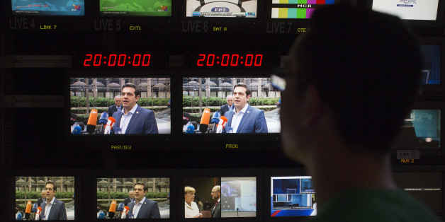 Alexis Tsipras, Greece's prime minister, center, is seen on television monitors in the television production gallery as he arrives in Brussels, ahead of a news broadcast by Skai Television, operated by the Skai Group, in Piraeus, Greece, on Sunday, July 12, 2015. Tsipras was given three days to push new austerity measures through parliament and keep alive Greece's chances of staying in the euro. Photographer: Simon Dawson/Bloomberg via Getty Images