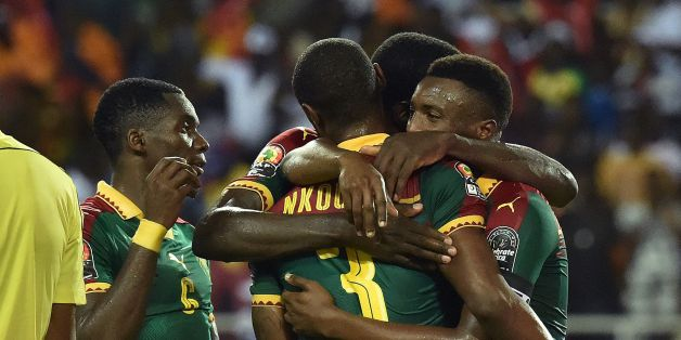 Cameroon's defender Nicolas Nkoulou is congratulated by team mates after scoring a goal during the 2017 Africa Cup of Nations final football match between Egypt and Cameroon at the Stade de l'Amitie Sino-Gabonaise in Libreville on February 5, 2017. / AFP / ISSOUF SANOGO        (Photo credit should read ISSOUF SANOGO/AFP/Getty Images)