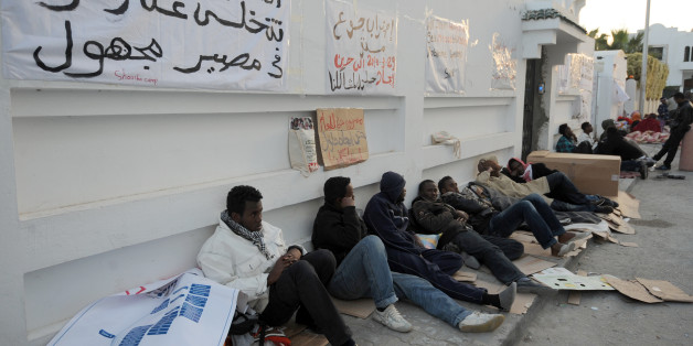 African refugees camp outside the headquarters of the High Commissioner for Refugees (UNHCR) in Tunis on April 3, 2013, as they participate in a hunger strike to demand their resettlement outside Tunisia. AFP PHOTO / FETHI BELAID        (Photo credit should read FETHI BELAID/AFP/Getty Images)