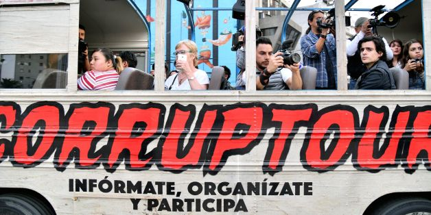 Journalists and tourists are pictured on board of  the 'Corruptour', a bus that offers a sightseeing tour through different points, institutions and companies in Mexico City, related to alleged great scandals of corruption in recent Mexican history, on February 5, 2017. The 'Corruptour' is a new and free touristic attraction launched and supported by NGO's and activists proposing a route arround 10 sites related to alleged corruption scandals such as the Mexican Senate, the offices of the Mexica