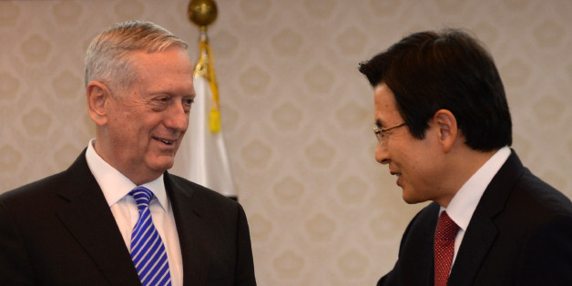 South Korea's acting President Hwang Kyo-ahn (R) greets US Defense Secretary James Mattis (L) prior their meeting at the Government Complex in Seoul on February 2, 2017.Mattis arrived in South Korea on February 2 on the first leg of a trip that also includes Japan, two key allies rattled by Donald Trump's isolationist ascent to power. / AFP / POOL / SONG Kyung-Seok        (Photo credit should read SONG KYUNG-SEOK/AFP/Getty Images)