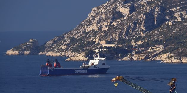 The cargo ship 'Stena Carrier' of the Corsica Linea shipping company, which employs foreign sailors and must start sea crossings between Marseille and Bastia in place of the SNCM shipping company, is anchored offshore on January 5, 2016, near the harbour of Marseille, after it was preventing from docking by SNCM and La Meridionale sailors on strike. / AFP / ANNE-CHRISTINE POUJOULAT        (Photo credit should read ANNE-CHRISTINE POUJOULAT/AFP/Getty Images)