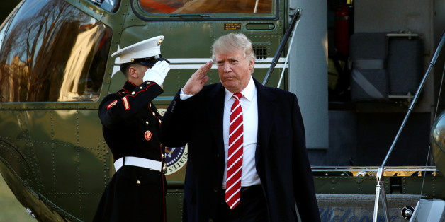 U.S. President Donald Trump returns a salute as he steps from Marine One upon his return to the White House in Washington February 6, 2017.  REUTERS/Kevin Lamarque
