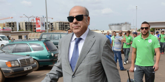 President of the Algerian Football Federation Mohamed Raouraoua arrives at Ouagadougou Airport in Burkina Faso on October 10, 2013, ahead of the 2014 World Cup qualifying football match between Burkina Faso and Algeria on October 12.   AFP PHOTO / FAROUK BATICHE        (Photo credit should read FAROUK BATICHE/AFP/Getty Images)