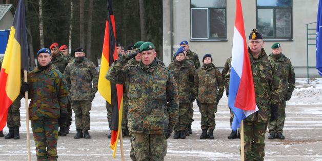 Commander of the NATO battalion battlegroup and the German contingent in Lithuania Lieutenant Colonel Christoph Huber salutes during a welcoming ceremony in Rukla, Lithuania, on February 7 , 2017. Lithuania welcomed several hundred German troops who will lead a multinational NATO battalion, one of four the alliance is deploying on a rotational basis this year to deter Russia by beefing up its eastern flank. / AFP / Petras Malukas        (Photo credit should read PETRAS MALUKAS/AFP/Getty Images)