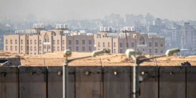 A picture taken from the southern Israel-Gaza Strip border on February 7, 2017 shows buildings in the the Gaza Strip behind Israel's controversial separation barrier. / AFP / JACK GUEZ        (Photo credit should read JACK GUEZ/AFP/Getty Images)