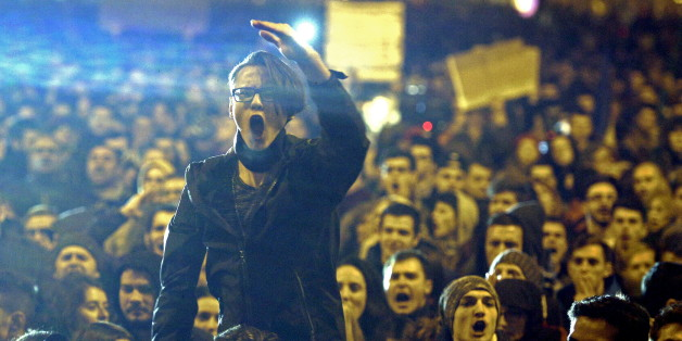 A demonstrator shouts anti corruption slogans during a street protest in Bucharest, Romania November 4, 2015. Romanian Prime Minister Victor Ponta quit on Wednesday in a surprise move that will probably produce a new cabinet led by a technocrat, after street protesters demanded resignations over a deadly fire in a Bucharest nightclub. An estimated 15,000 people marched in Bucharest on Wednesday evening, and thousands more poured onto the streets of cities across Romania, saying the government's