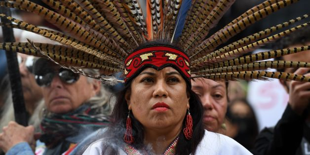 Native Americans lead demonstrators as they march to the Federal Building in protest against President Donald Trump's executive order fast-tracking the Keystone XL and Dakota Access oil pipelines, in Los Angeles, California on February 5, 2017. US President Donald Trump has revived two pipeline projects blocked by his predecessor on environmental grounds. / AFP / Mark RALSTON        (Photo credit should read MARK RALSTON/AFP/Getty Images)