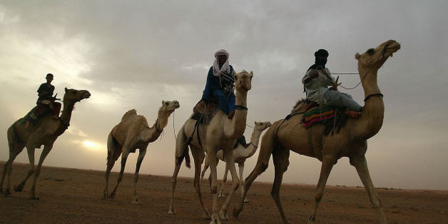 Nomadic guides ride their camels in May 2003 in the Saharan desert in southern Algeria around the city of Illizi. 31 European tourists are missing in Algeria since mid-February. The tourists, 15 Germans, 10 Austrians, 4 Swiss nationals, a Dutchman and a Swede, are feared to have been kidnapped by an armed group or by smugglers. They were travelling in six separate groups in four-wheel vehicles and motorbikes without guides when they disappeared over the period of one month in the vast Sahara, wh