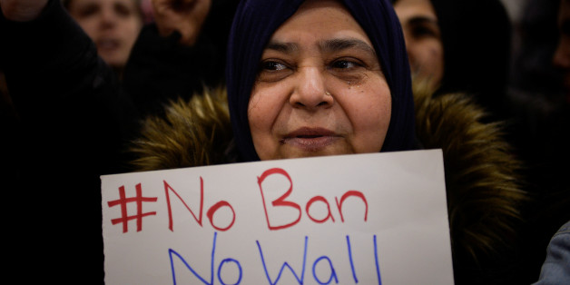 A Muslim women holds a sign during anti-Donald Trump travel ban protests outside Philadelphia International Airport in Philadelphia, Pennsylvania, U.S., January 29, 2017. REUTERS/Charles Mostoller
