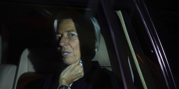 Managing Director of the International Monetary Fund (IMF) Christine Lagarde looks from a car after she arrived at Entebbe Airport on January 25, 2017 for a visit to Uganda. / AFP / Isaac Kasamani        (Photo credit should read ISAAC KASAMANI/AFP/Getty Images)
