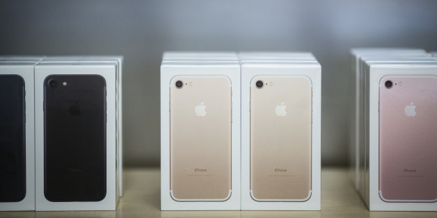 Boxes of iPhone 7 smartphones are displayed at an Apple Inc. in New York, U.S., on Friday, Sept. 16, 2016. Shoppers looking to buy Apple Inc.'s new iPhone 7 smartphones on Friday better have ordered ahead. Brisk demand left some stores sold out, leaving those who purchased online with the best chance to get their hands on the latest models -- and some resorting to extreme measures. Photographer: John Taggart/Bloomberg via Getty Images