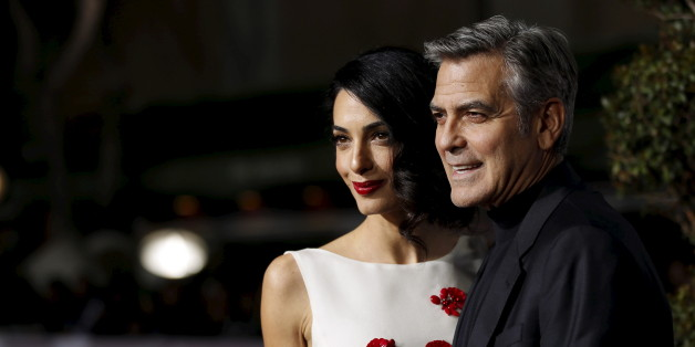 "Cast member George Clooney and his wife Amal pose at the premiere of ""Hail, Caesar!"" in Los Angeles, California February 1, 2016. The movie opens in the U.S. on February 5.   REUTERS/Mario Anzuoni"