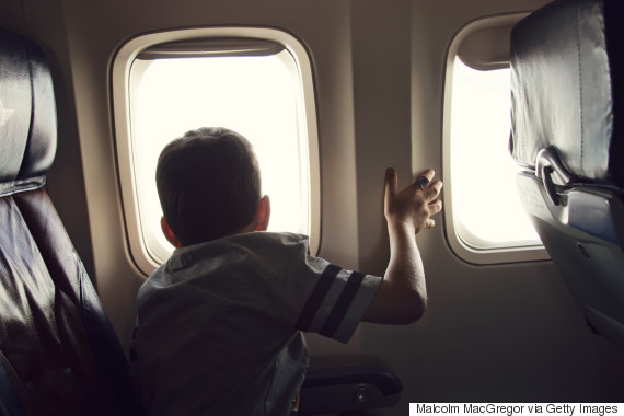 child looking out plane window