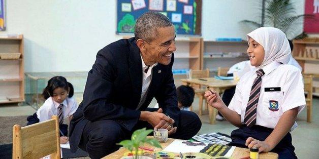Obama avec une jeune réfugiée en 2015