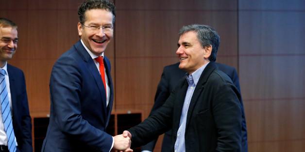 Dutch Finance Minister and Eurogroup President Jeroen Dijsselbloem greets Greek Finance Minister Euclid Tsakalotos (R) during a euro zone finance ministers meeting in Brussels, Belgium December 5, 2016. REUTERS/Francois Lenoir