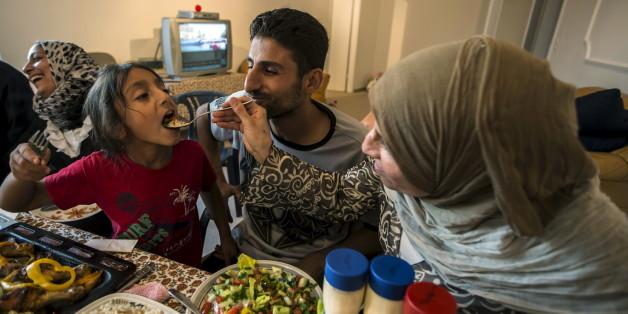 Dürfte es aus Sicht vieler EU-Bürger nicht mehr geben: Eine glückliche muslimische Familie in Europa