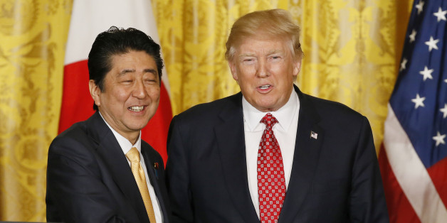 Japanese Prime Minister Shinzo Abe (L) and U.S. President Donald Trump shake hands following their joint press conference at the White House in Washington, U.S., February 10, 2017.    REUTERS/Jim Bourg  TPX IMAGES OF THE DAY