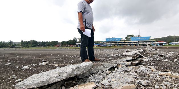 A man looks at the damaged runway of the dometic airport after a 6.5-magnitude earthquake struck overnight in Surigao City in southern island of Mindanao on February 11, 2017.   A strong quake shook the southern Philippines on February 10, killing at least three people, toppling buildings and sending panicked residents fleeing their homes, media reports and authorities said. / AFP / ERWIN MASCARINAS        (Photo credit should read ERWIN MASCARINAS/AFP/Getty Images)