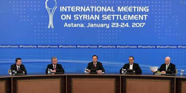 Kazakh Foreign Minister Kairat Abdrakhmanov (C) reads a final statement on Syria peace talks as UN envoy for Syria Staffan de Mistura (R) looks through his papers in Astana on January 24, 2017. / AFP / Kirill KUDRYAVTSEV        (Photo credit should read KIRILL KUDRYAVTSEV/AFP/Getty Images)