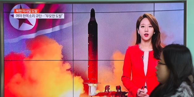 A woman walks past a television screen showing file footage of North Korea's missile launch at a railway station in Seoul on February 12, 2017. North Korea fired a ballistic missile on February 12 in an apparent provocation to test the response from new US President Donald Trump, the South Korean defence ministry said. / AFP / JUNG Yeon-Je        (Photo credit should read JUNG YEON-JE/AFP/Getty Images)