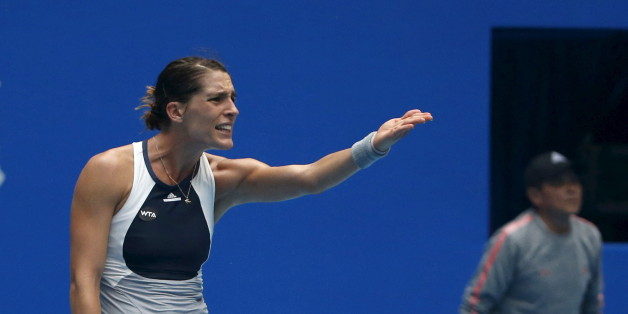 Andrea Petkovic of Germany gestures during a women's singles match against Sara Errani of Italy at the China Open tennis tournament in Beijing, China, October 7, 2015.    REUTERS/Kim Kyung-Hoon