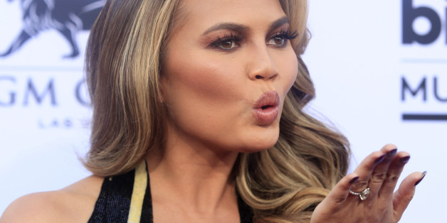 Model Chrissy Teigen blows as kiss as she arrives at the 2015 Billboard Music Awards in Las Vegas, Nevada May 17, 2015. REUTERS/L.E. Baskow