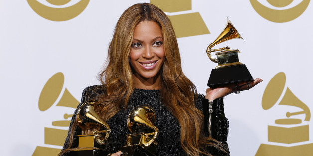 "Beyonce holds the awards she won for Best R&B Performance and Best R&B Song for ""Drunk in Love"" and Best Surround Sound Album for ""Beyonce"" in the press room at the 57th annual Grammy Awards in Los Angeles, California February 8, 2015.  REUTERS/Mike Blake  (UNITED STATES - TAGS: ENTERTAINMENT) (GRAMMYS-BACKSTAGE)"