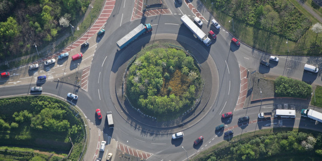 An aerial shot of a small but busy traffic island