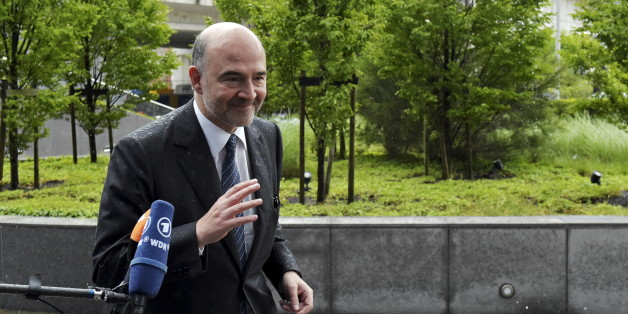 "European Economic and Financial Affairs Commissioner Pierre Moscovici arrives at a Eurozone finance ministers emergency meeting on Greece in Brussels, Belgium June 22, 2015. A new Greek offer for a cash-for-reforms deal raised hopes of an agreement as euro zone leaders prepared for an emergency summit on Monday, with EU officials welcoming the proposals as a ""good basis for progress"" to avert a default by Athens. REUTERS/Eric Vidal"