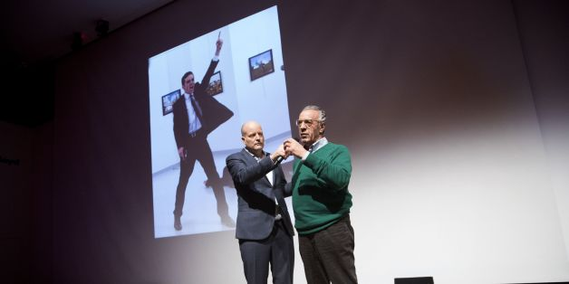 Winner of the World Press Photo 2016 photographer Burhan Ozbilici (R) and Managing Director of the World Press Photo Foundation Lars Boering, speak on stage during the announcement of the World Press Photo prizes in Amsterdam, on February 13, 2017.Brandishing a gun, his face contorted with rage, the shocking image of a Turkish policeman assassinating the Russian envoy to Turkey won the prestigious World Press Photo Award on February 13, 2017.  / AFP / ANP / JEROEN JUMELET / Netherlands OUT