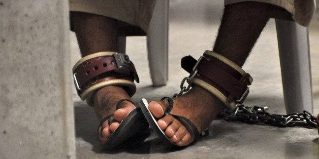 "In this photo, reviewed by a U.S. Department of Defense official, a Guantanamo detainee's feet are shackled to the floor as he attends a ""Life Skills"" class inside the Camp 6 high-security detention facility at Guantanamo Bay U.S. Naval Base in this file pool photo taken April 27, 2010. Nearly two-thirds of Americans believe torture can be justified to extract information from suspected terrorists, according to a Reuters/Ipsos poll, a level of support similar to that seen in countries like Niger"
